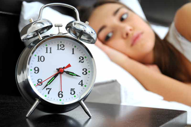 Woman suffering from insomania