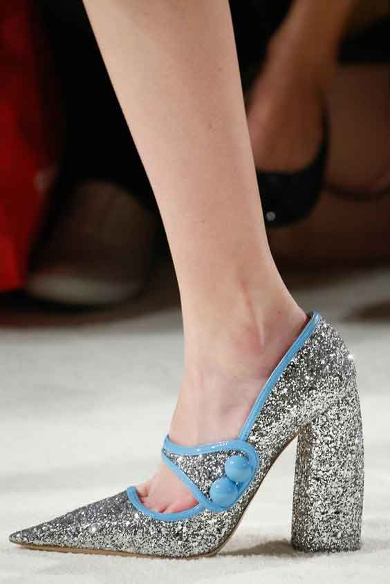 Shoes adorned with glitter, jewels, fluffy adornments