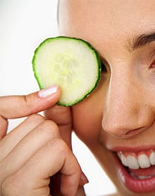 Cucumber on a woman's face for glowing skin