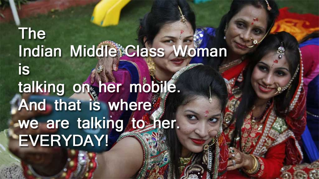 dusbus.com talking to India's middle class women on her mobile phone