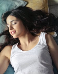 A girl sleeping in the right direction as per Vastu Shastra