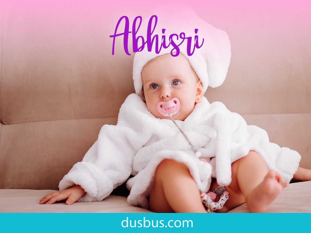 Baby girl wearing a white cute bathing gown with pacifier in her mouth