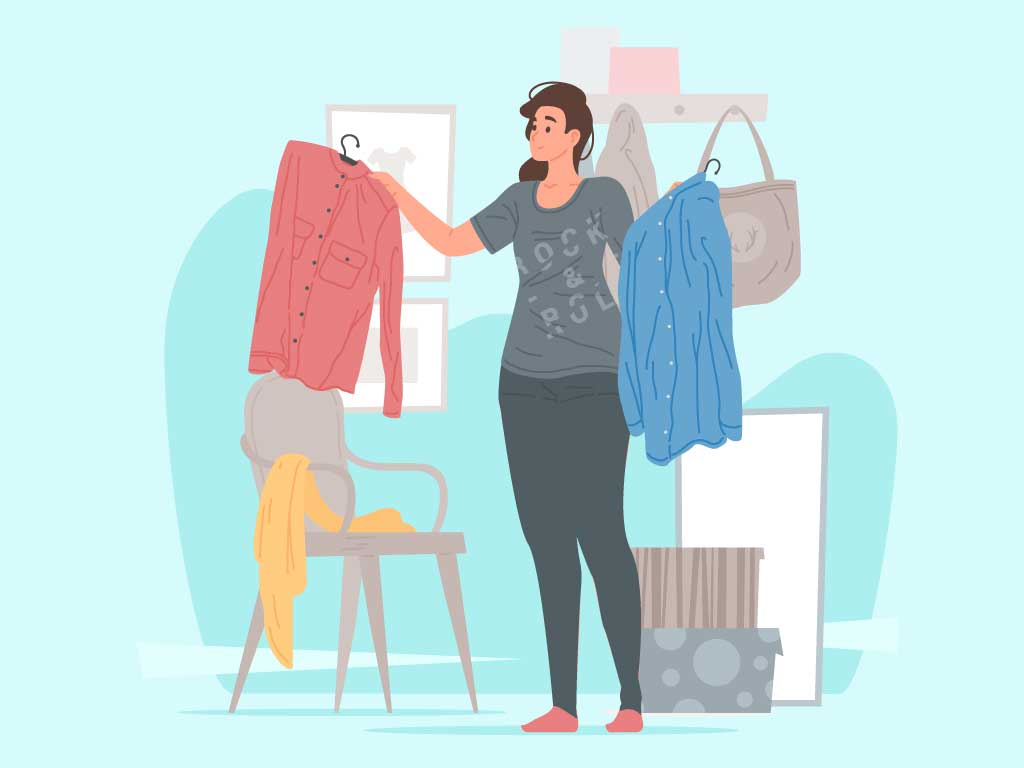 Girl trying to arrange her clothes in order to downsize her wardrobe