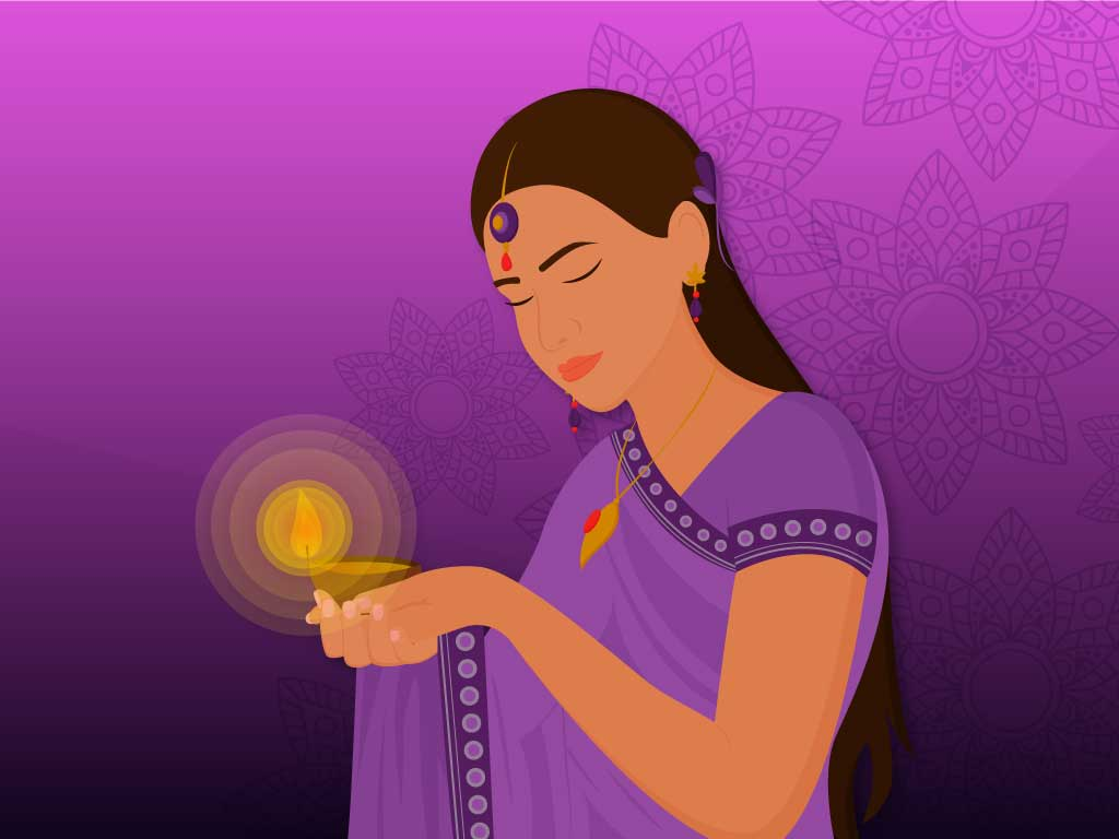 Traditional Indian girl holding a diya