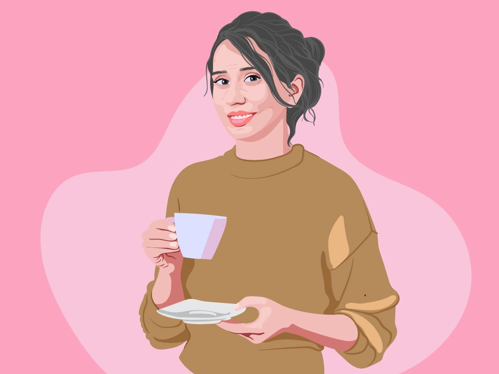 Women in her 50s wearing a sweater while holding a cup of tea