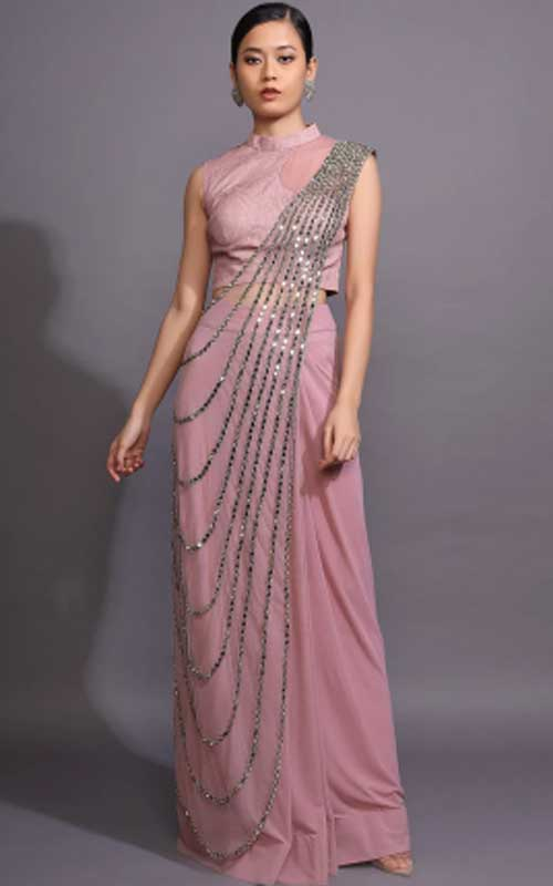 A mauve-pink saree-gown with a mirror work drape