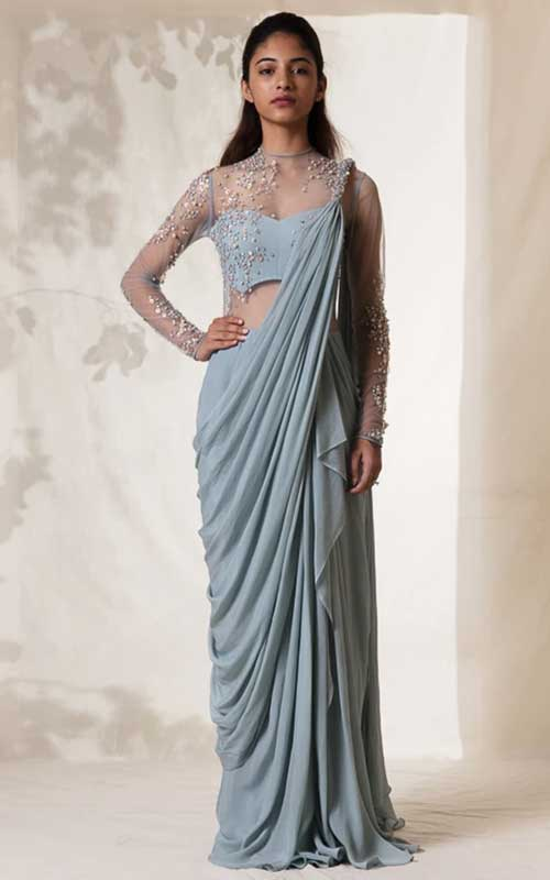 A pearlescent, blue saree gown
