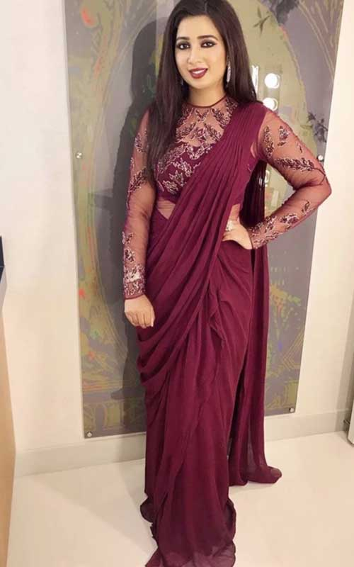 A beautiful maroon ensemble with sheer blouse