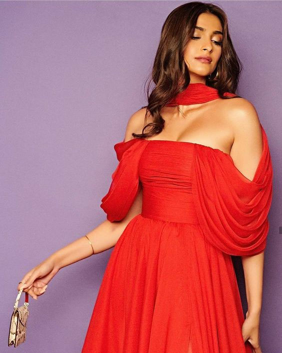 Sonam Kapoor with minimal makeup wearing a red western dress