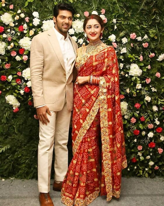 Girl in red sindoor wearing red saree posing with her hubby