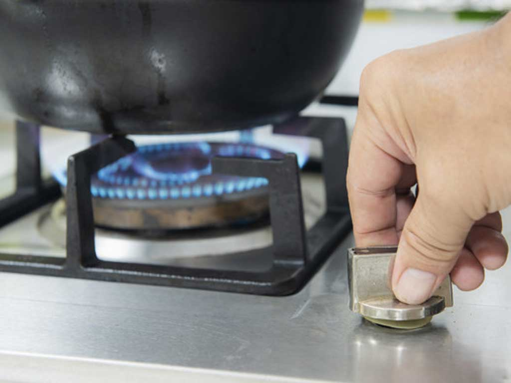Turning On Gas Stove