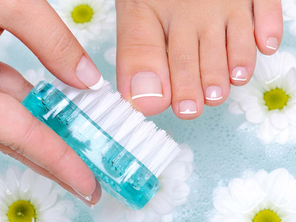 clean nail with brush